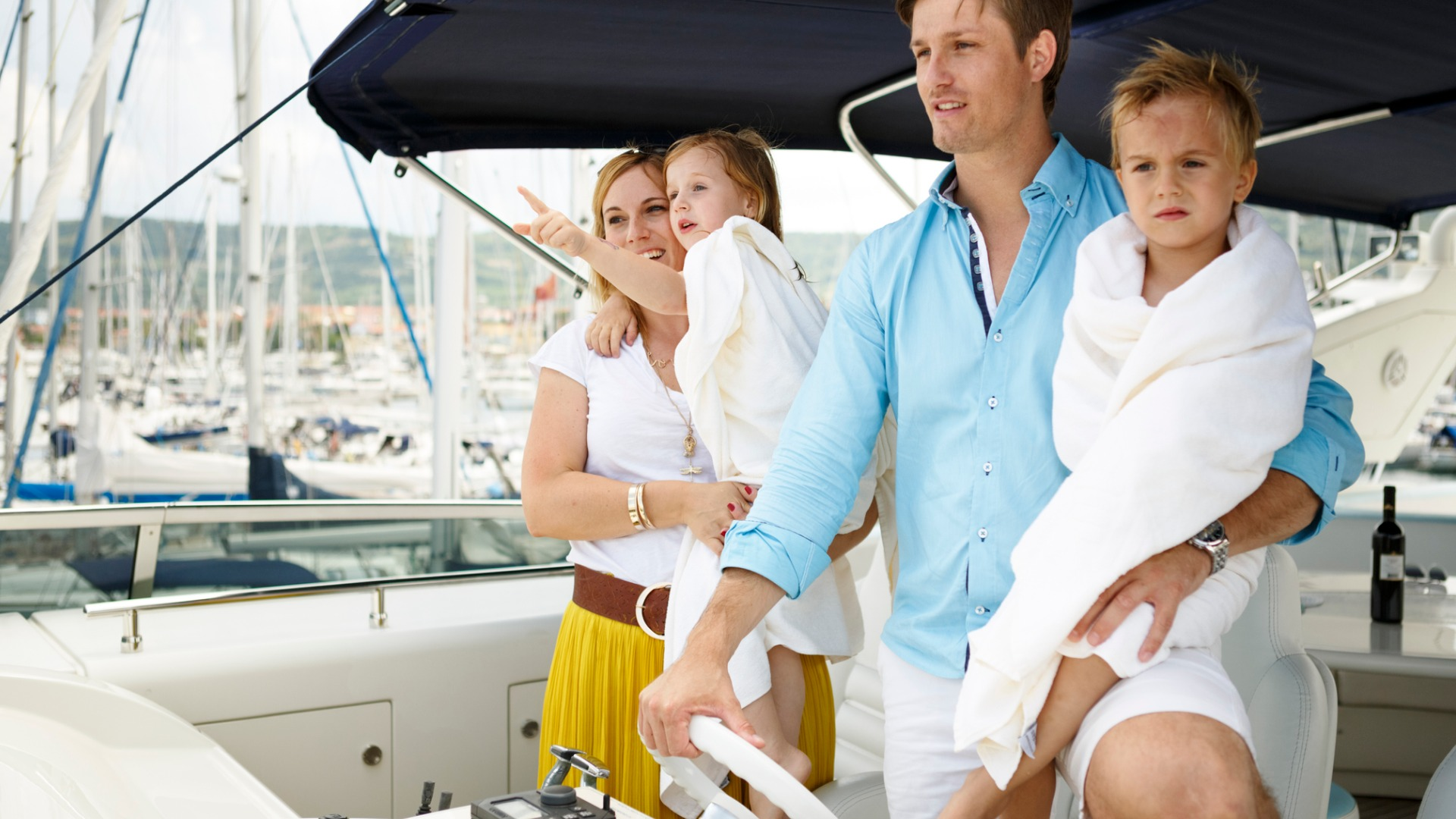 family-relaxing-on-yacht-for-holidays-picture-id517543708