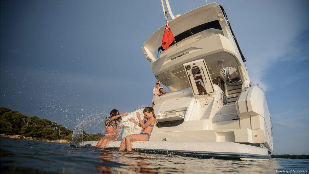 Kids enjoying the sea on a sunseeker yacht
